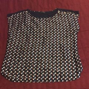 Dolman style blouse with heart prints.